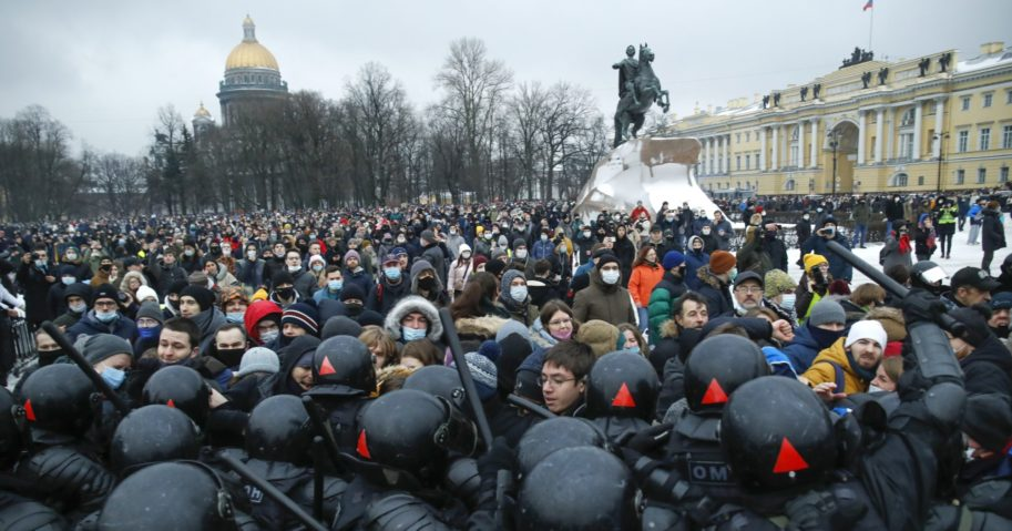 People clash with police during a protest against the jailing of opposition leader Alexei Navalny in St. Petersburg, Russia, on Jan. 23, 2021.