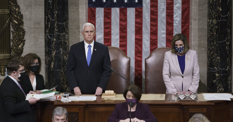 Vice President Mike Pence and House Speaker Nancy Pelosi, D-Calif., read the final certification of Electoral College votes cast in November's presidential election during a joint session of Congress that ended early Thursday.