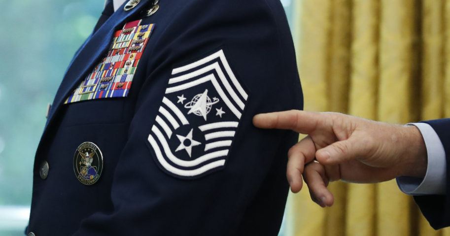 Chief Master Sgt. Roger Towberman displays his insignia during a presentation of the United States Space Force flag in the Oval Office of the White House in Washington, D.C., on May 15, 2020.