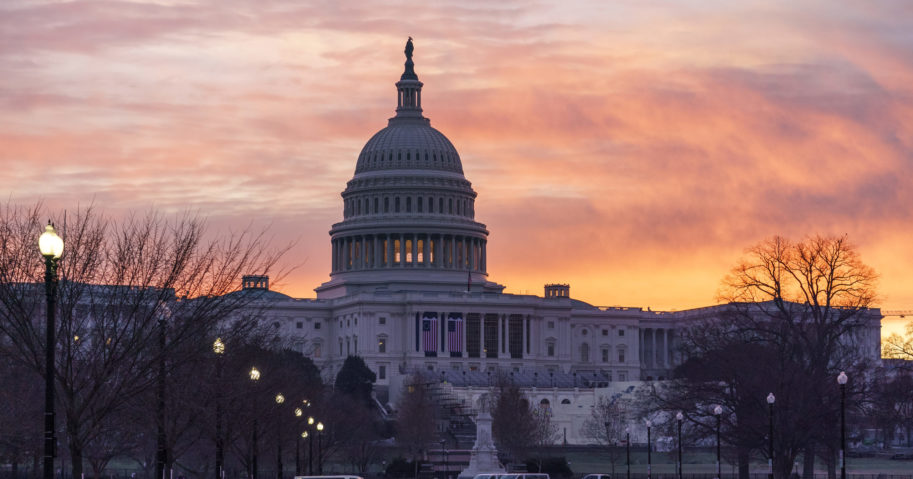 Dawn breaks at the Capitol in Washington, D.C., on Jan. 11, 2021.