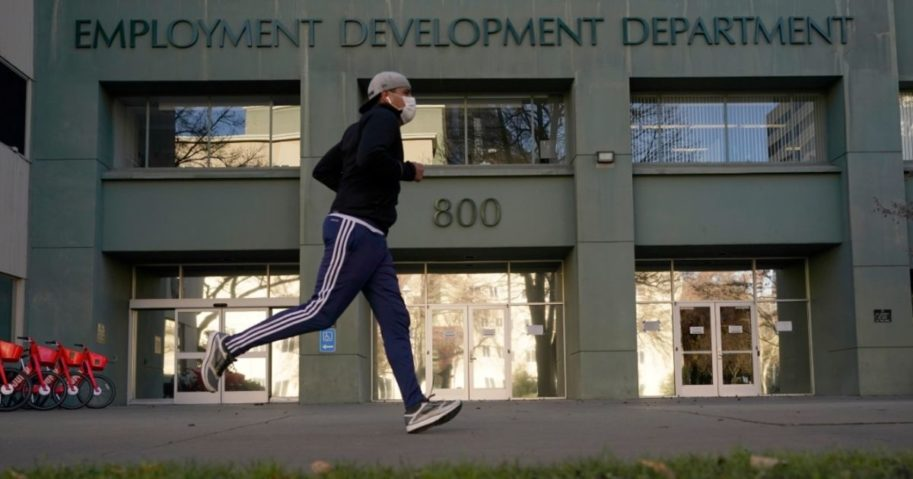 A runner passes the office of the California Employment Development Department in Sacramento, California, on Dec. 18, 2020.