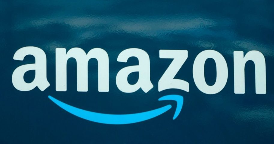 In this file photo, an Amazon logo appears on an Amazon delivery van on Oct. 1, 2020, in Boston.
