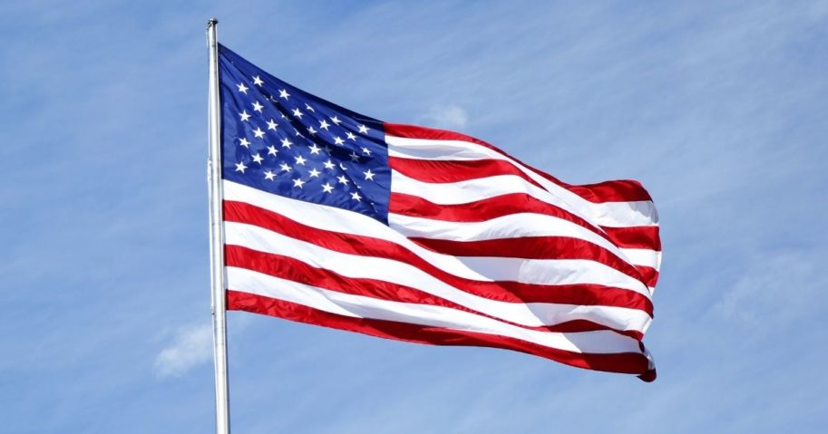 The U.S. flag flies from a flagpole.