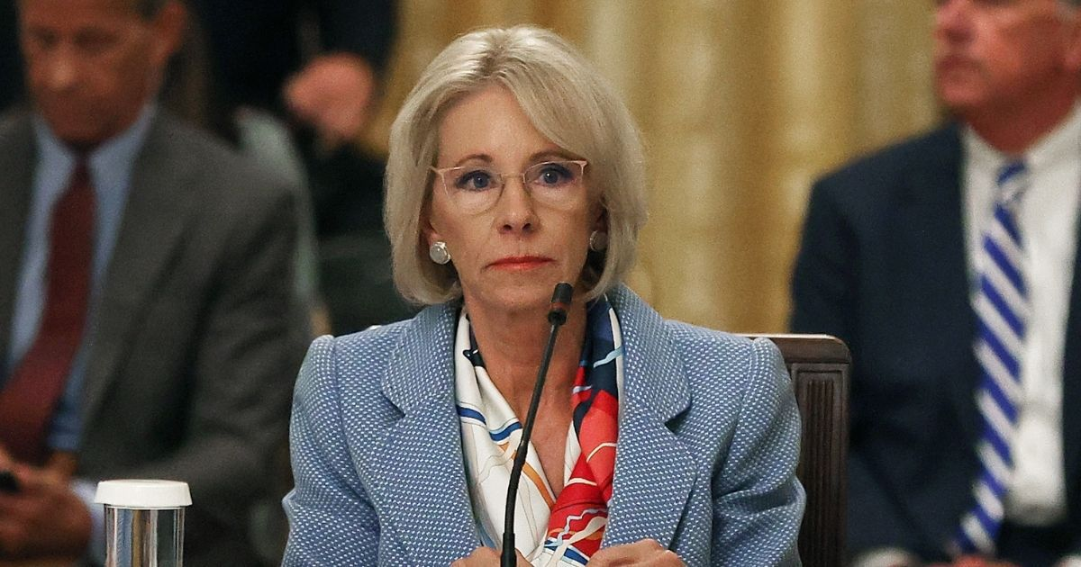 Then-Secretary of Education Betsy DeVos attends a July 7, 2020, event hosted in the White House by President Donald Trump regarding how to safely re-open schools during the coronavirus pandemic.