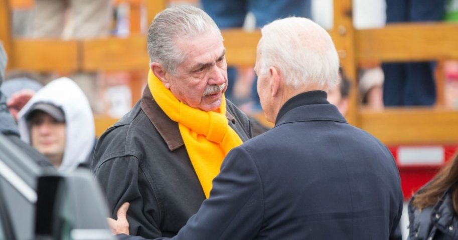 President Joe Biden speaks with UFCW President Marc Perrone before a speech in support of striking union workers on April 18, 2019, in Dorchester, Massachusetts.