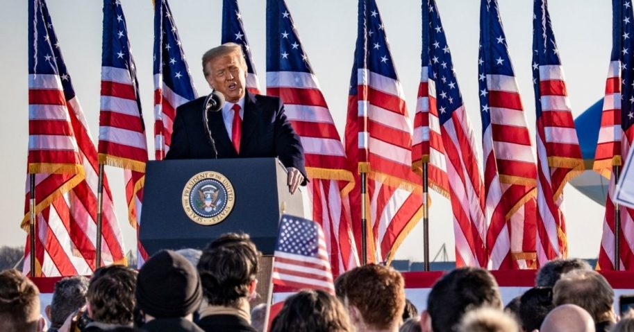 Former President Donald Trump speaks to supporters at Joint Base Andrews before boarding Air Force One for his last time as president on Wednesday.