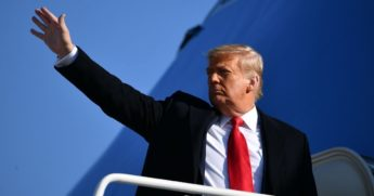 President Donald Trump waves as he makes his way to board Air Force One before departing from Andrews Air Force Base in Maryland on Jan. 12.