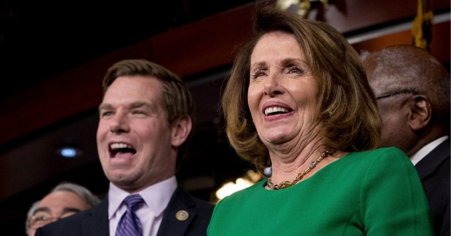 Then-House Minority Leader Nancy Pelosi, right, and California Democratic Rep. Eric Swalwell laugh at a news conference on Capitol Hill in Washington on March 24, 2017.