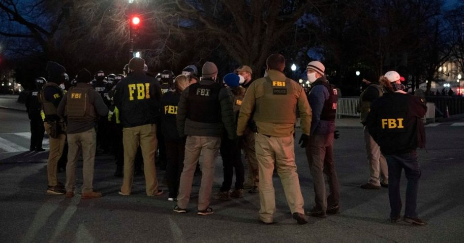 A team of FBI agents gather as demonstrators rally outside of the U.S. Capitol on Jan. 6, 2021, in Washington.