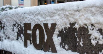 The Fox logo sign is covered in snow outside the News Corp. building in New York City on Dec. 17.