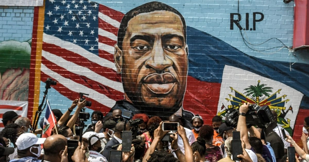 A mural depicting George Floyd is unveiled on a sidewall of CTown Supermarket on July 13, 2020, in the Brooklyn borough of New York City.