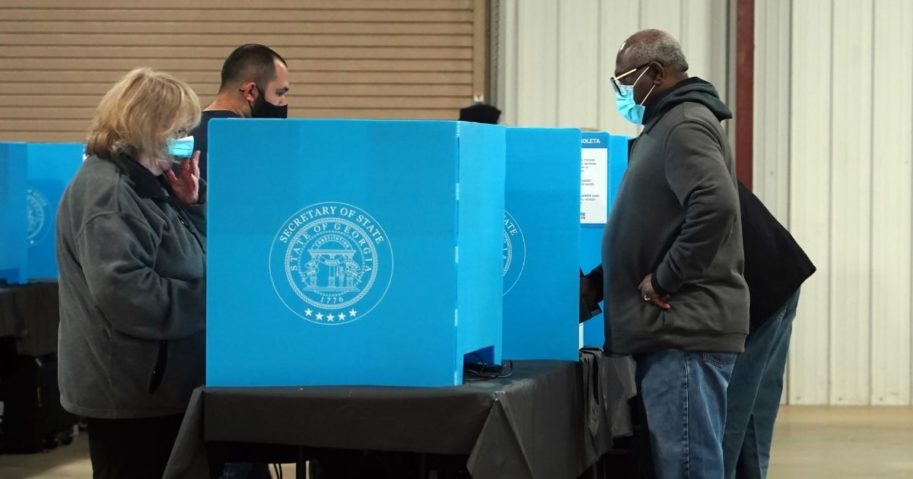 Georgia voters mark their ballots during the first day of early voting in the U.S. Senate runoffs at the Gwinnett County Fairgrounds on Dec. 14, 2020, in Atlanta.