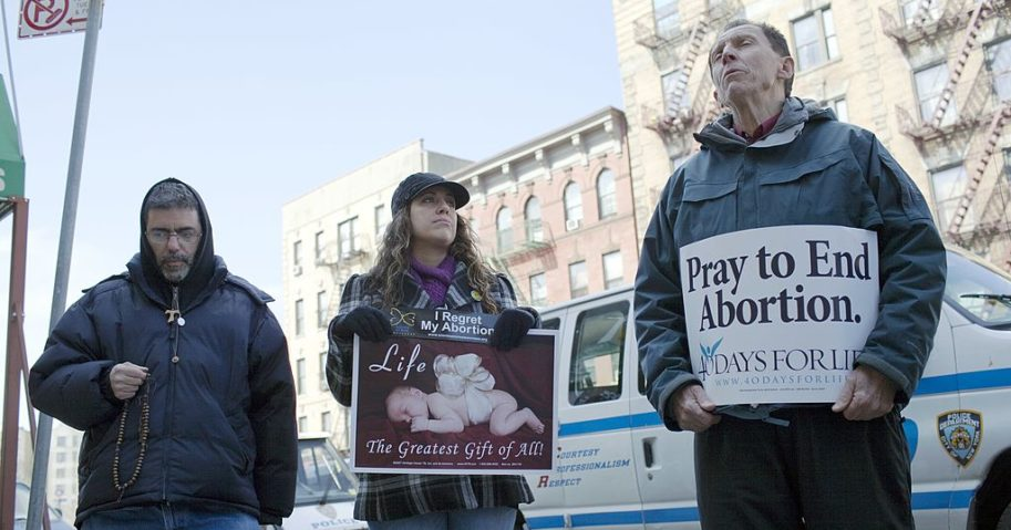 Pro-life protesters line the sidewalk outside the Dr. Emily Women's Health Center March 12, 2011, in Bronx, New York.