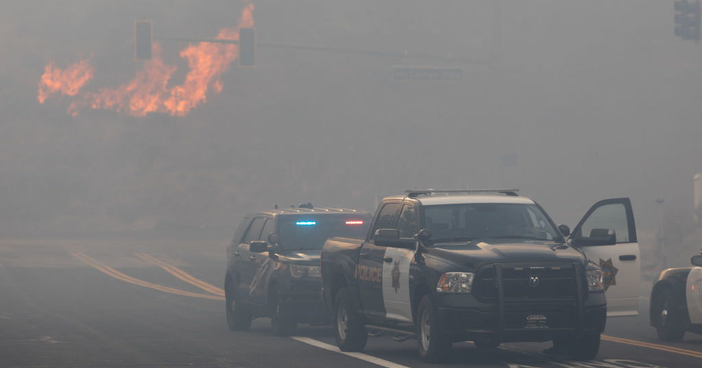 Reno police block road access while engulfed in wildfire smoke from the Pinehaven Fire on Nov. 17, 2020 in Reno, Nevada.