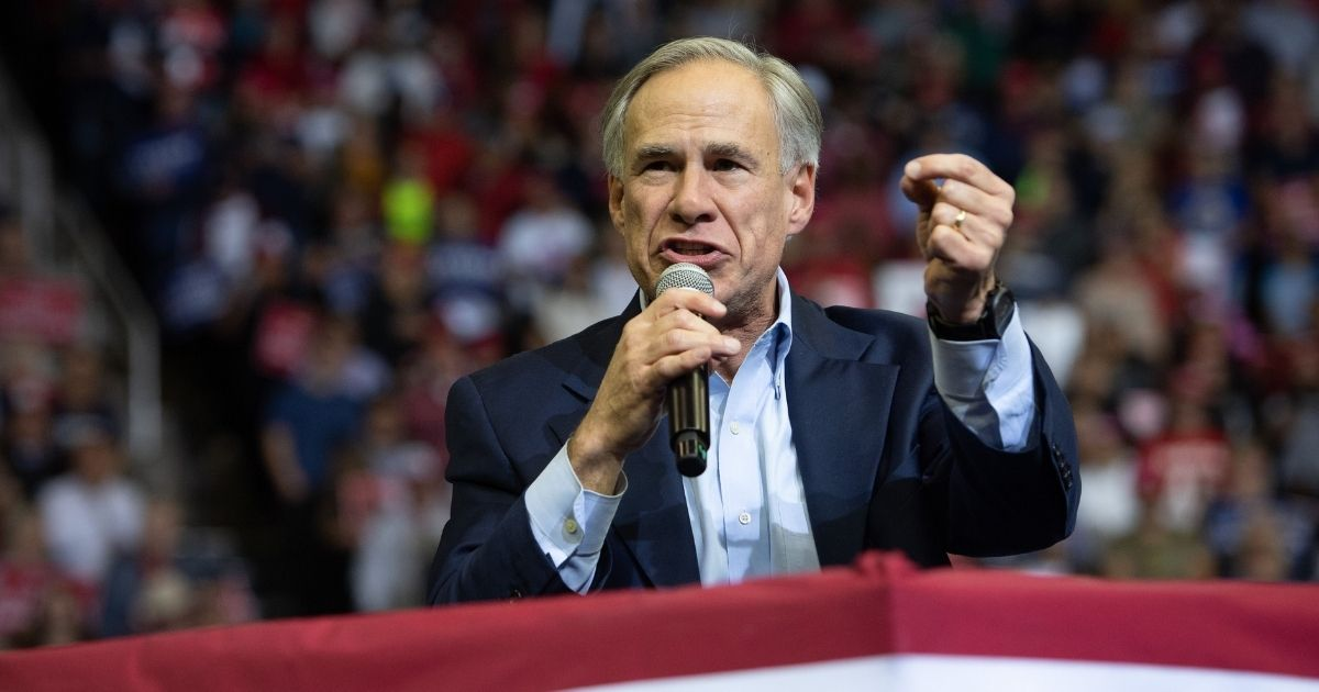 Texas Republican Gov. Greg Abbott speaks during a campaign rally by then-President Donald Trump at the Toyota Center in Houston, Texas, on Oct. 22, 2018.