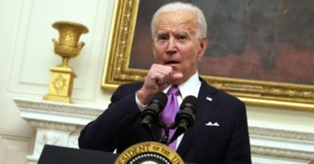 President Joe Biden clears his throat as he speaks during an event in the State Dining Room of the White House in Washington on Thursday.