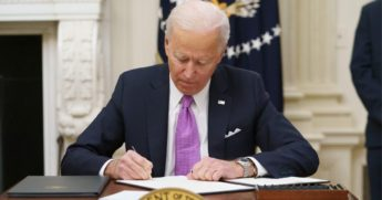 President Joe Biden signs executive orders in the State Dining Room of the White House in Washington on Thursday.