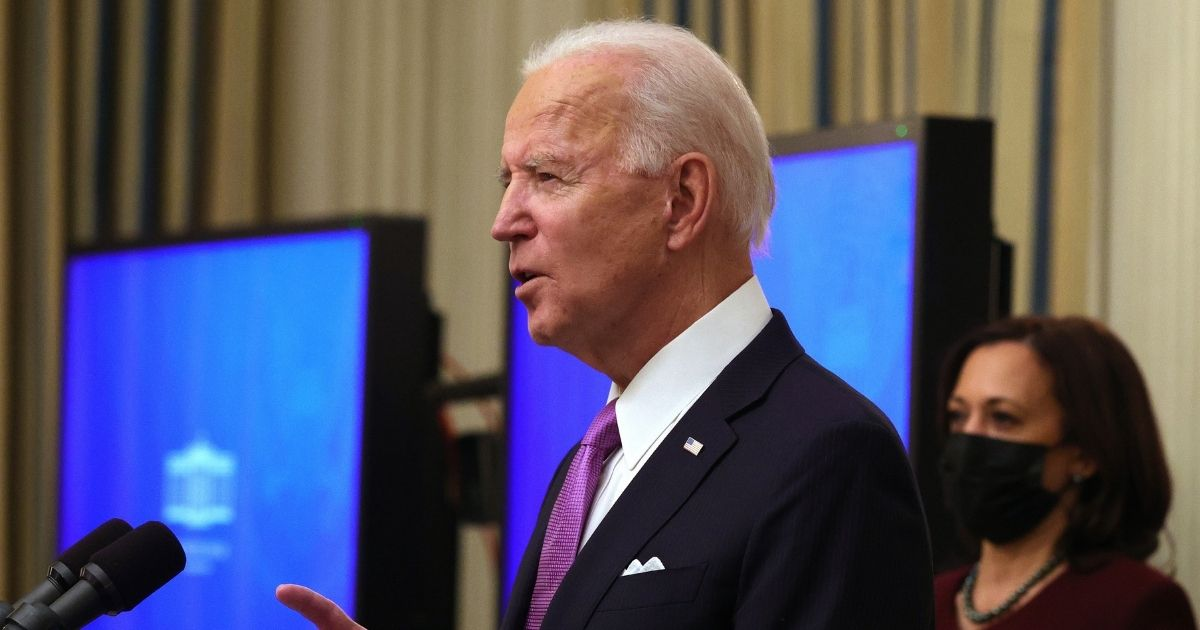 President Joe Biden speaks as Vice President Kamala Harris looks on during an event at the State Dining Room of the White House on Thursday in Washington, D.C.