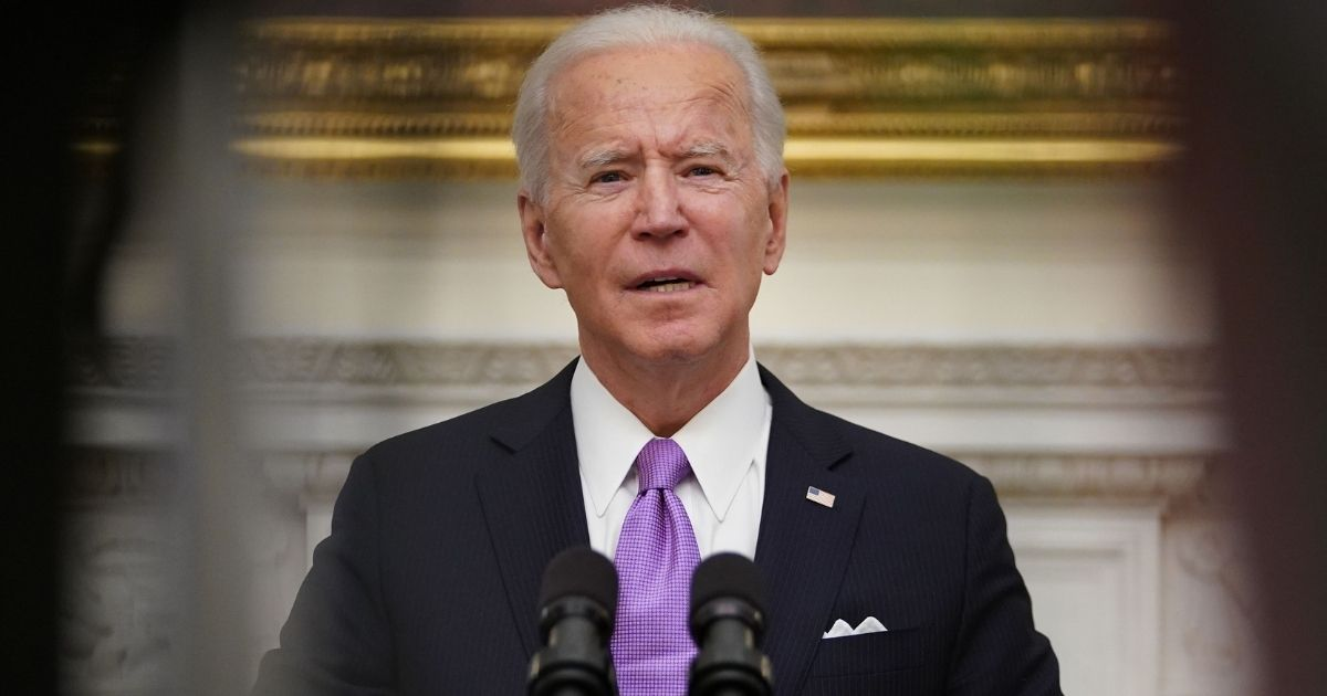 President Joe Biden speaks about the COVID-19 response before signing executive orders in the State Dining Room of the White House in Washington, D.C., on Thursday.