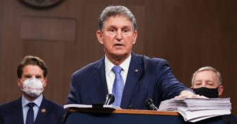 West Virginia Democratic Sen. Joe Manchin speaks alongside a bipartisan group of Democrat and Republican members of Congress as they announce a proposal for a COVID-19 relief bill on Capitol Hill on Dec. 14, 2020, in Washington, D.C.