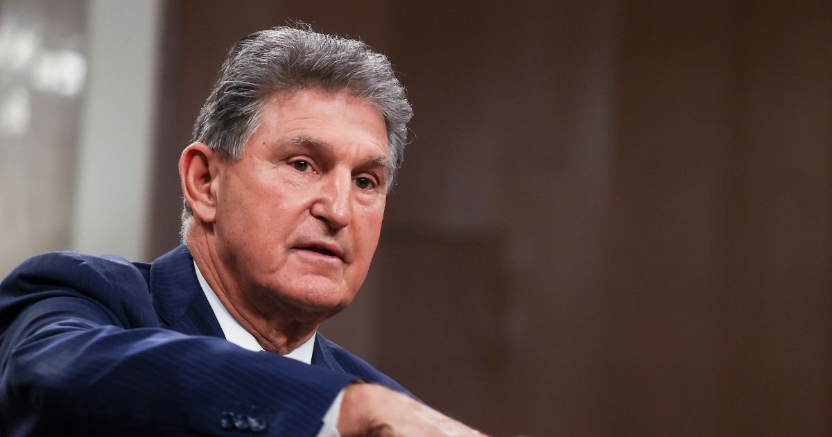 Democratic Sen. Joe Manchin of West Virginia speaks alongside a bipartisan group of Democratic and Republican members of Congress as they announce a proposal for a COVID-19 relief bill on Capitol Hill on Dec. 14, 2020, in Washington, D.C.