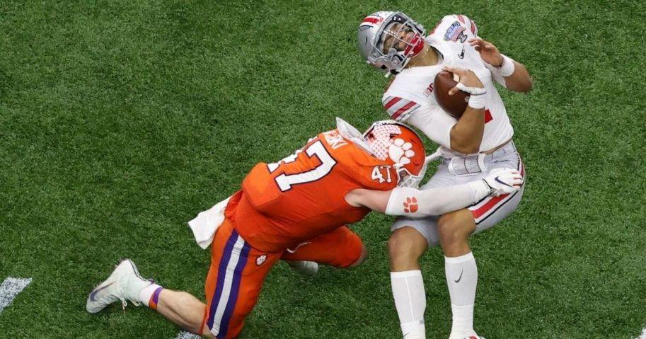 Ohio State quarterback Justin Fields gets hit by Clemson linebacker James Skalski during the first half of the Sugar Bowl NCAA college football game Jan. 1, 2021, in New Orleans. Skalski was ejected from the game for targeting.