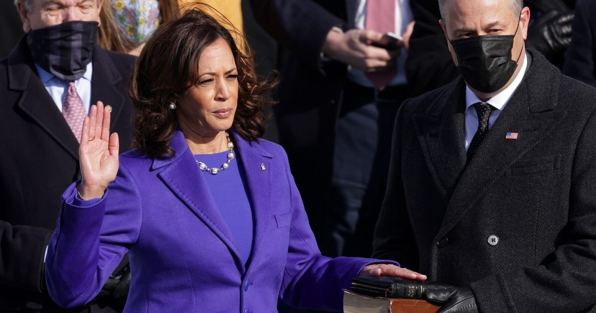 Kamala Harris, dressed in purple, is sworn as vice president by Supreme Court Associate Justice Sonia Sotomayor as her husband, Doug Emhoff, looks on at the inauguration of President Joe Biden at the U.S. Capitol in Washington on Wednesday.