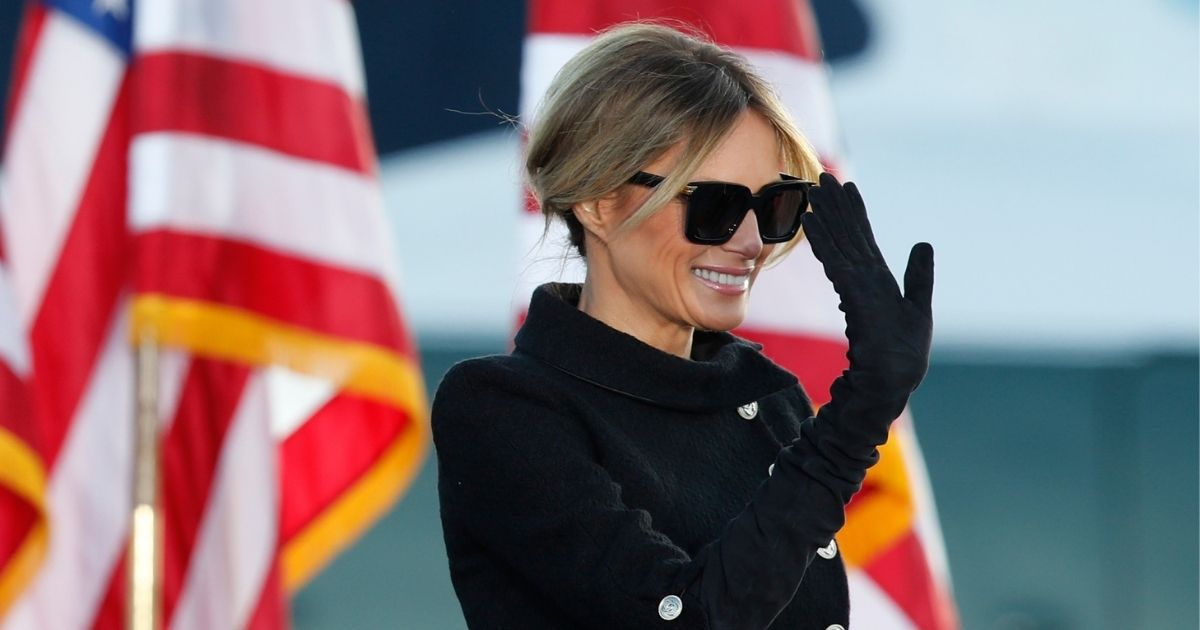 First lady Melania Trump waves to supporters after President Donald Trump's speech at Andrews Air Force Base, Maryland, on Wednesday.