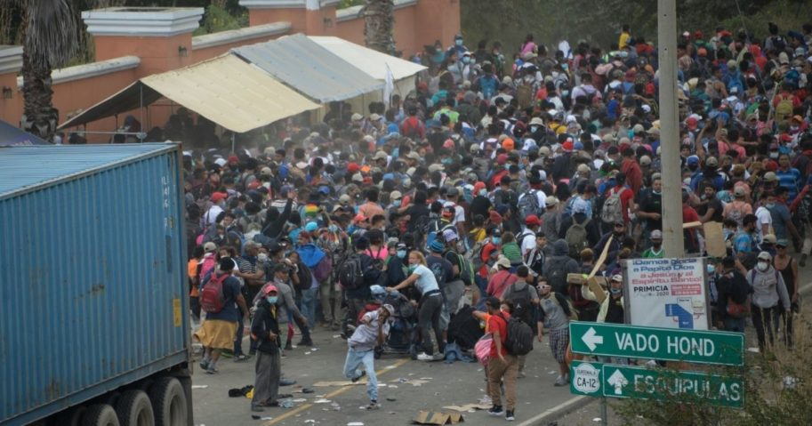 Migrants who arrived in a caravan from Honduras on their way to the United States are dispersed by security forces in Vado Hondo, Guatemala, on Monday.