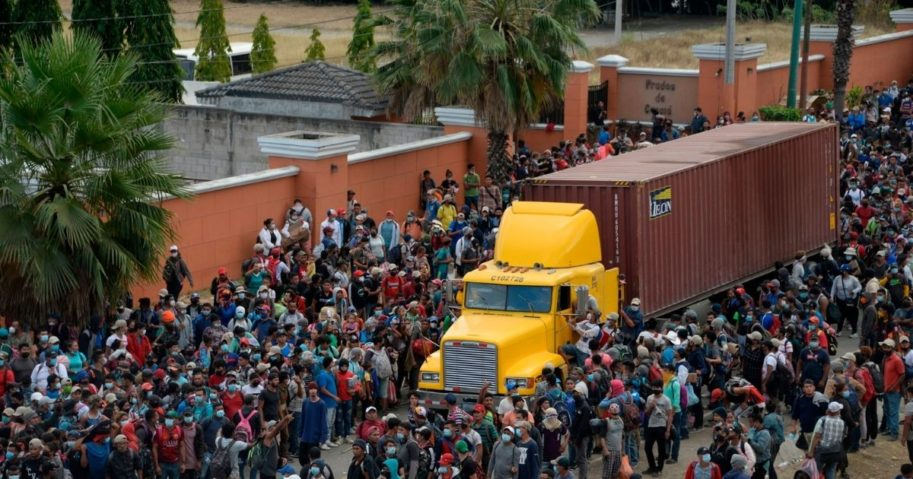 Migrants who arrived in a caravan from Honduras on their way to the United States are blocked by security foces in Vado Hondo, Guatemala, on Monday.