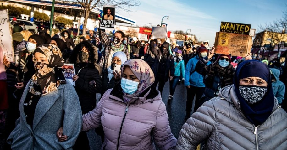 Protesters rally against police brutality Sunday in Minneapolis at the gas station where Dolal Idd was shot by Minneapolis police several days earlier.
