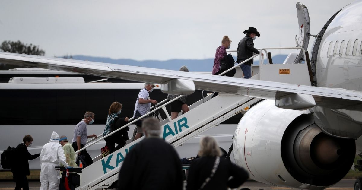 Passengers board a charter plane at Oakland International Airport on March 10, 2020, in Oakland, California.