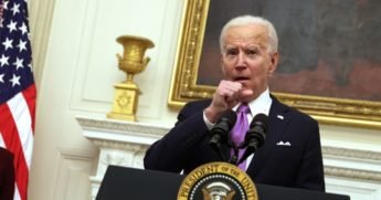 President Joe Biden clears his throat as he speaks during an event at the State Dining Room of the White House on Thursday in Washington, D.C.
