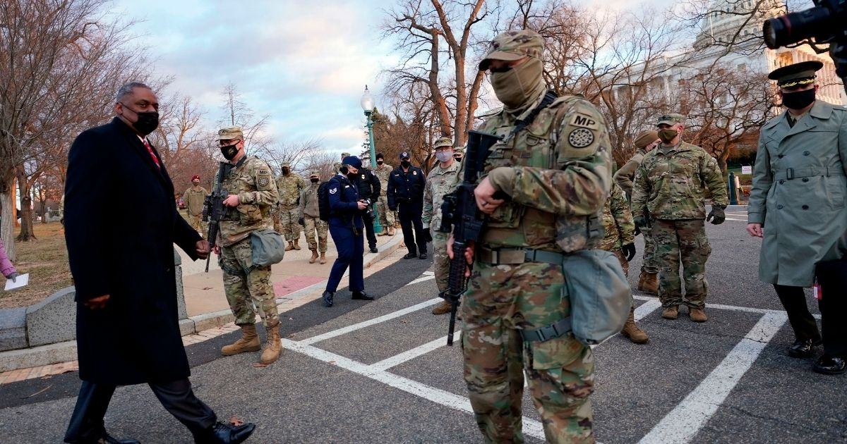 Secretary of Defense Lloyd Austin visits National Guard troops deployed at the US Capitol and its perimeter, on Friday on Capitol Hill in Washington.