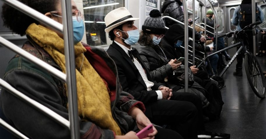 People ride on a subway train while wearing masks at a Brooklyn station on Nov. 18, 2020, in New York City.