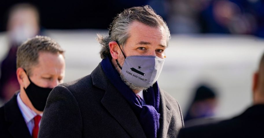 """Republican Sen. Ted Cruz of Texas, wearing a face mask that reads, """"Come and Take It,"""" arrives at the inauguration of President Joe Biden on the West Front of the U.S. Capitol on Wednesday in Washington, D.C."""