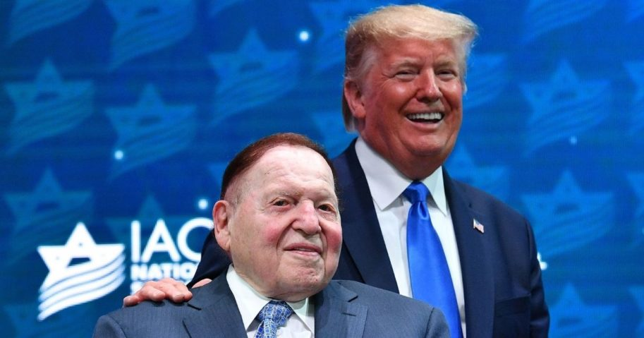 President Donald Trump stands with Sheldon Adelson before his address to the Israeli American Council National Summit 2019 at the Diplomat Beach Resort in Hollywood, Florida, on Dec. 7, 2019.