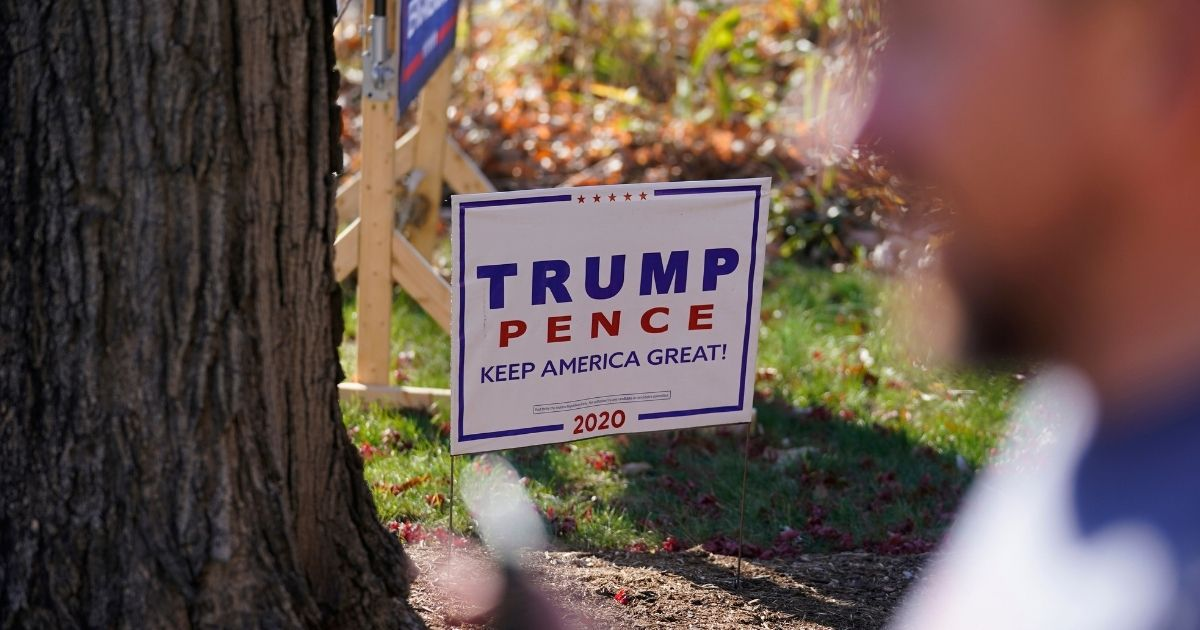 A sign in support of President Donald Trump's re-election campaign is posted in a front yard in Terre Haute, Indiana, on Nov. 11.