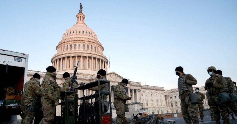 Weapons are distributed to members of the National Guard outside the U.S. Capitol on Wednesday in Washington, D.C.