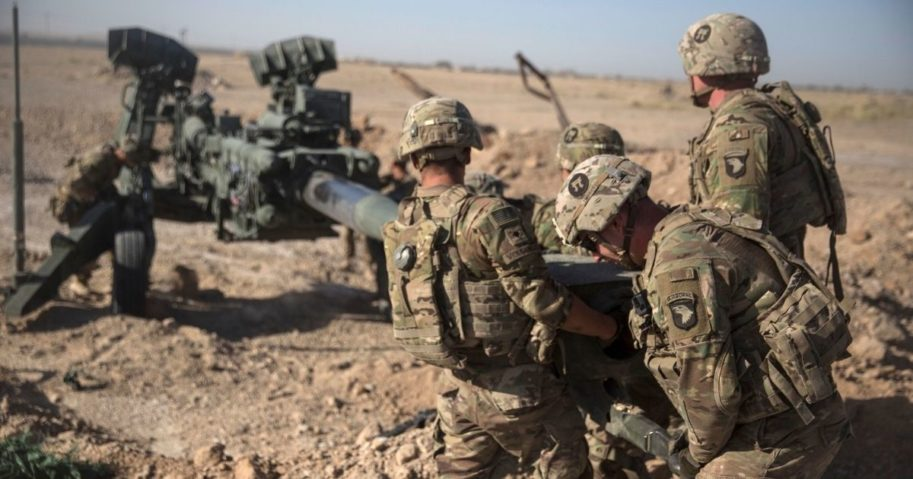 U.S. soldiers with Task Force Iron maneuver an M-777 howitzer, so it can be towed into position at Bost Airfield, Afghanistan, on June 10, 2017.