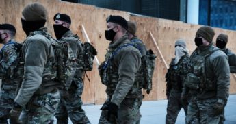 Members of the National Guard patrol the streets in Washington prior to Wednesday's scheduled inauguration of President-elect Joe Biden.