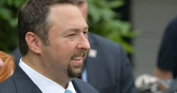 Jason Miller, a key adviser to former President Donald Trump, waits for Trump's departure on Marine One from the South Lawn of the White House on June 17, 2017.