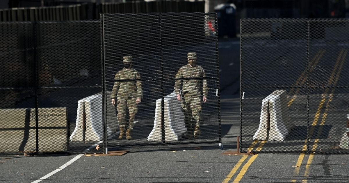 Members of the National Guard staff security barriers near the National Mall in Washington a day after the inauguration of President Joe Biden.