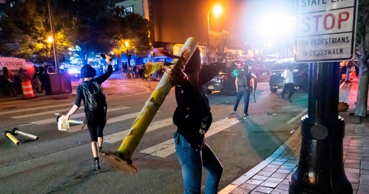 Rioters wreak destruction in Atlanta on May29 as protests turned violent around the country in the wake of the death of counterfeiting suspect George Floyd while in Minneapolis police custody May 25.