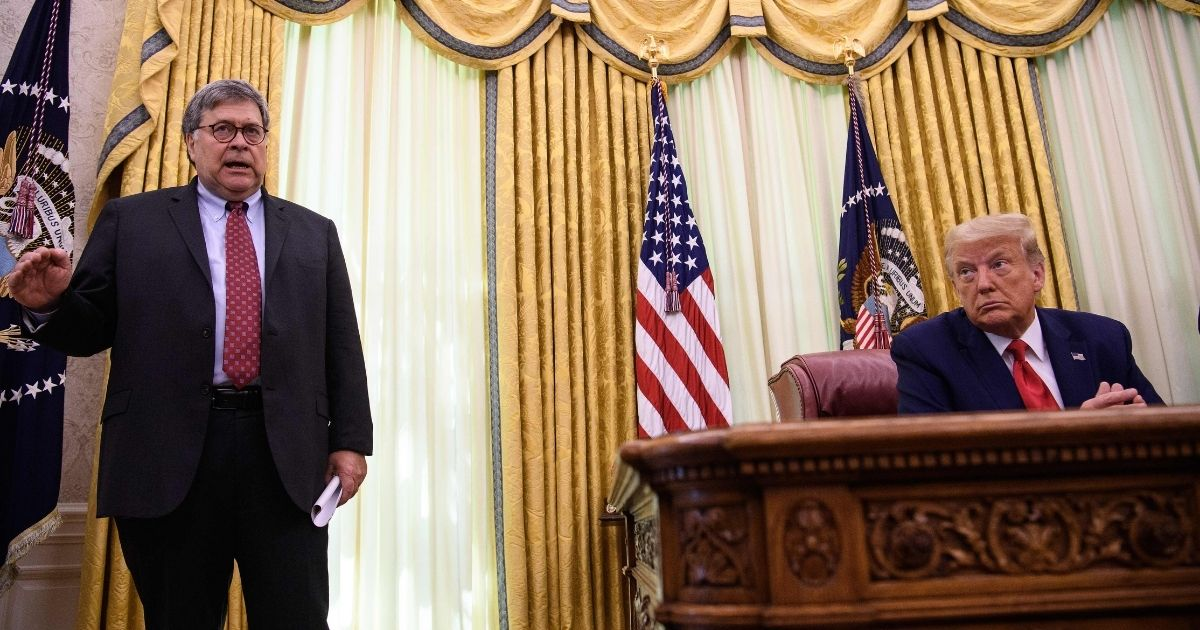 President Donald Trump listens to then-Attorney General Bill Barr, left, in the Oval Office at the White House after receiving a briefing from top law enforcement officials on operations against the MS-13 gang in Washington, D.C, on July 15, 2020.