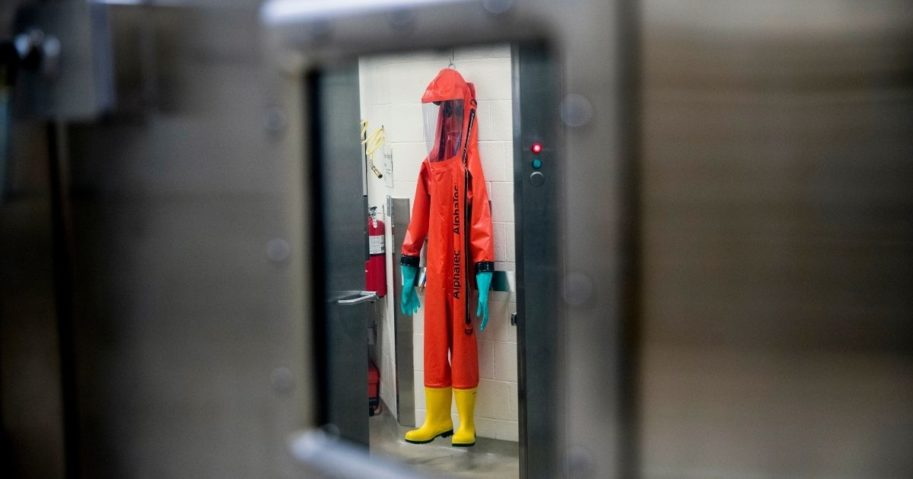 In this March 19, 2020, file photo, a biosafety protective suit for handling viral diseases is hung up in a biosafety level 4 training facility at U.S. Army Medical Research and Development Command at Fort Detrick.