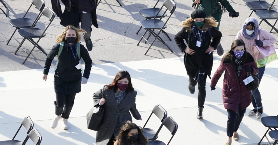People evacuate from the front of the U.S. Capitol in Washington on Monday during a rehearsal of President-elect Joe Biden's inauguration.