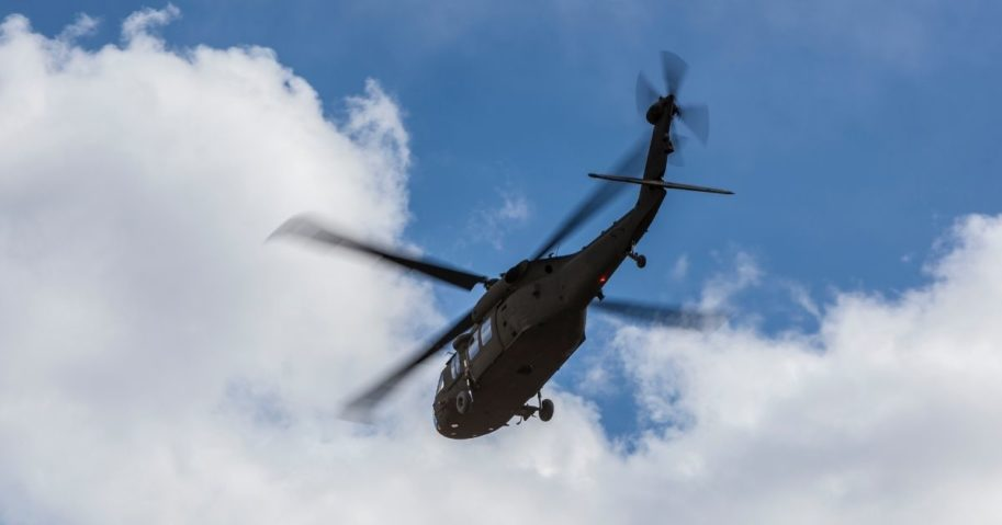 A Black Hawk helicopter flies in this stock image.