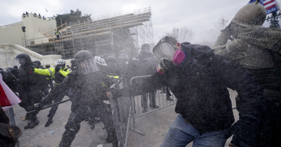 Trump supporters try to break through a police barrier on Jan. 6, 2021, at the Capitol in Washington.