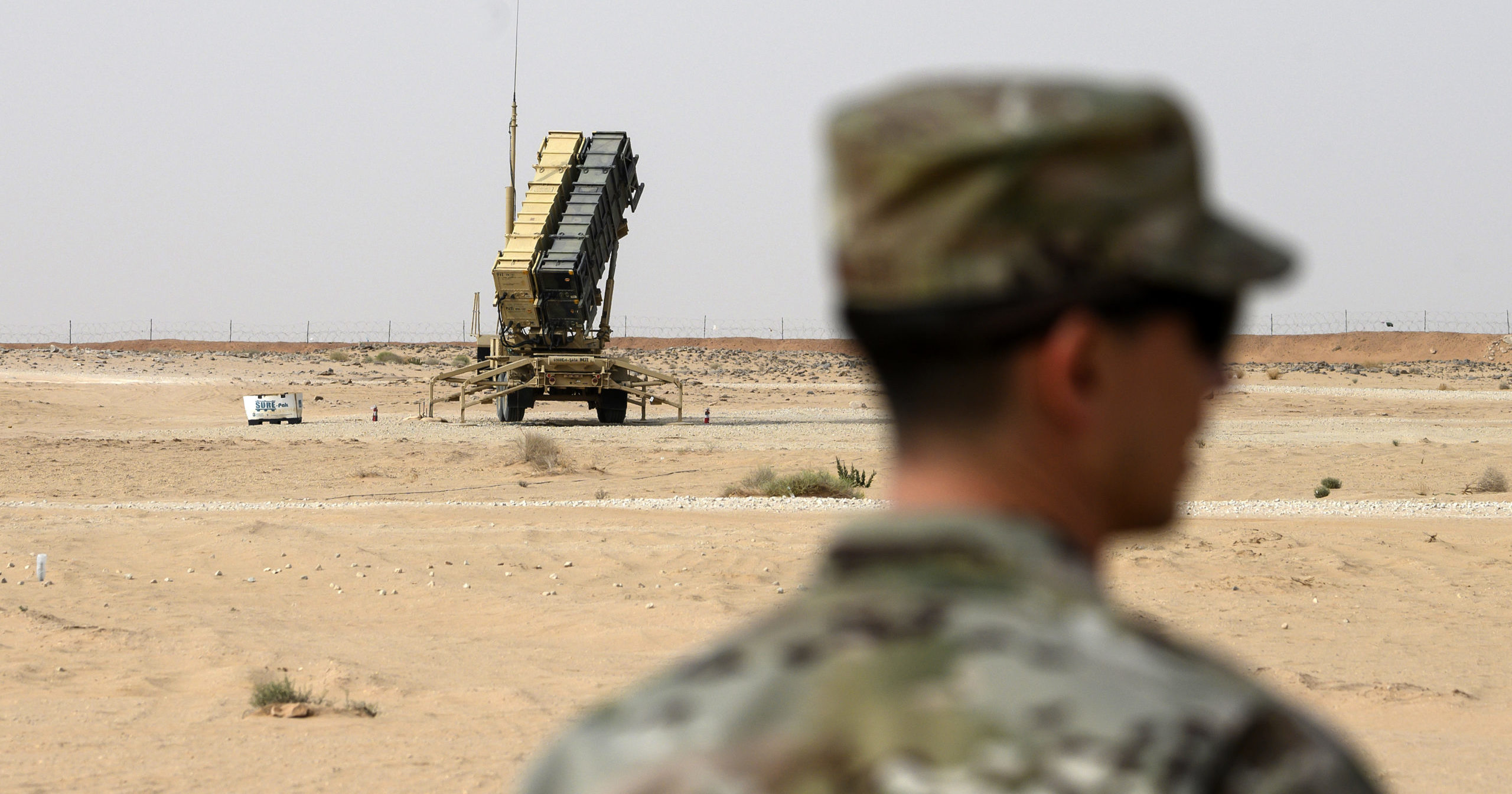 A member of the U.S. Air Force stands near a missile battery at the Prince Sultan Air Base in al-Kharj, Saudi Arabia, on Feb. 20, 2020.